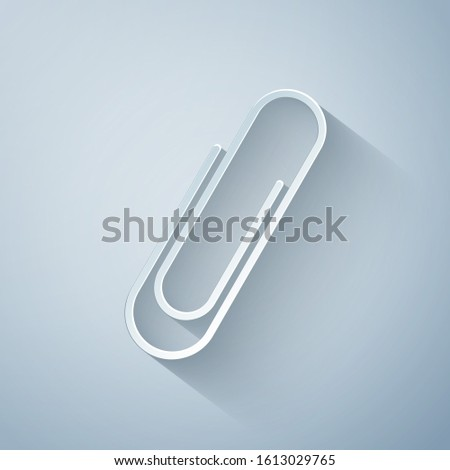 Paper cut Paper clip icon isolated on grey background. Paper art style