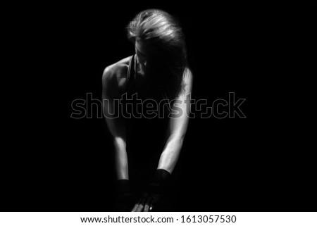 athletic caucasian female sitting on floor black and white photo #1613057530