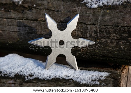 Shuriken (throwing star), traditional japanese ninja cold weapon stuck in wooden background #1613095480