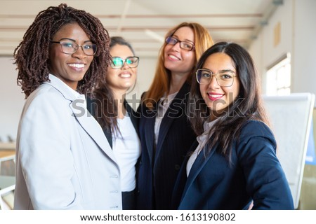 Group of confident young businesswomen looking at camera. Beautiful smiling women posing. Female confidence concept #1613190802