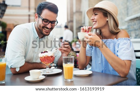 Romantic couple drinking coffee and enjoying in fruit desserts, having fun in the cafe. Dating, love, relationships #1613193919