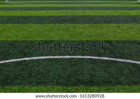 Green grass field, soccer field, soccer field background. #1613280928