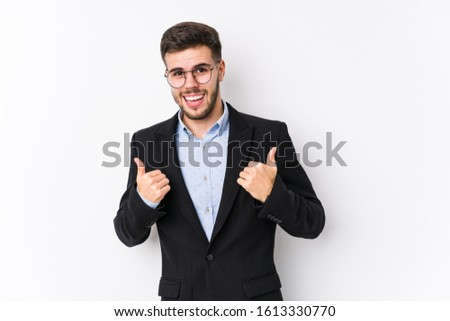 Young caucasian business man posing in a white background isolated Young caucasian business man raising both thumbs up, smiling and confident. #1613330770