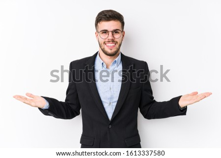 Young caucasian business man posing in a white background isolated Young caucasian business man showing a welcome expression. #1613337580