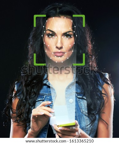 Biometric verification. Young woman. The concept of a technology of face recognition on polygonal grid. IT security and protection ID