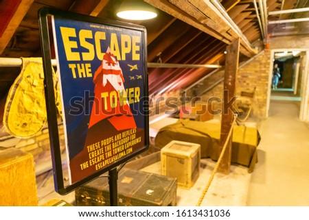 Toronto, Ontario, Canada - Jan 4 2020 - Interior of Casa Loma Castle - escape the tower sign #1613431036