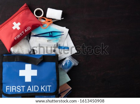 First aid medical kit on wood background,copy space,top view #1613450908