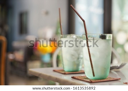 Water or mineral water in clear glasses placed on the restaurant table, blurred restaurant background         #1613535892