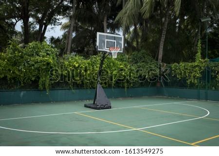 Empty basketball court in outdoor outdoor field #1613549275
