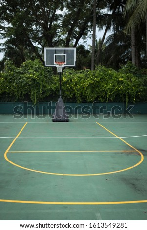 Empty basketball court in outdoor outdoor field #1613549281
