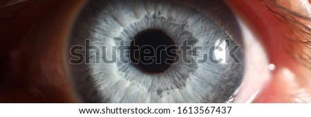 Blue eye male human super macro closeup. Healthy vision test concept #1613567437