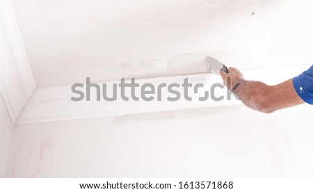 Master renovating the ceiling. Renovation #1613571868