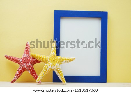 photo frame space copy mock up and starfish decoration