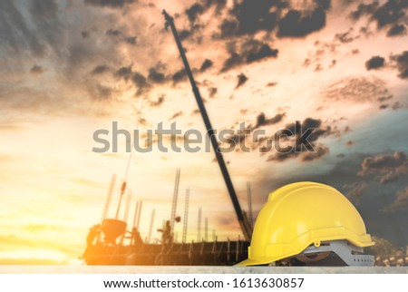 helmet in construction site and construction site worker background safety first concept #1613630857