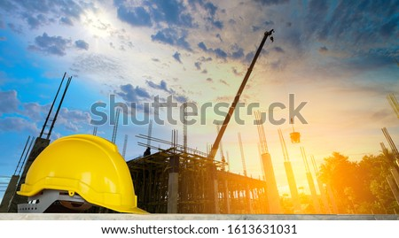 helmet in construction site and construction site worker background, safety first concept #1613631031