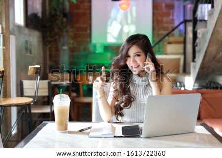 Business selling online, young asian woman in casual dress working on computer for e-business commerce, businesswoman owner SME small business contact with customers and showing thumb up meaning like #1613722360