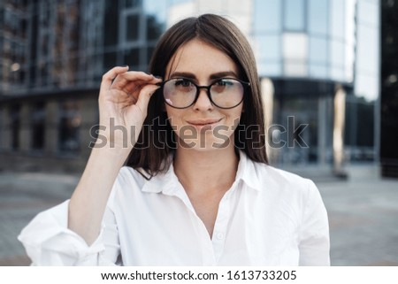 Portrait of One Fashionable Girl Dressed in Jeans and White Shirt, Business Lady, Woman Power Concept #1613733205
