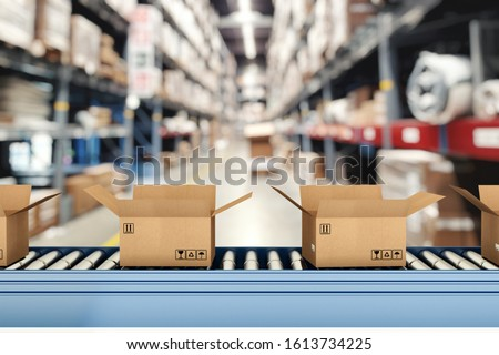 Cardboard boxes on conveyor rollers inside a warehouse ready to be shipped by courier for distribution Royalty-Free Stock Photo #1613734225