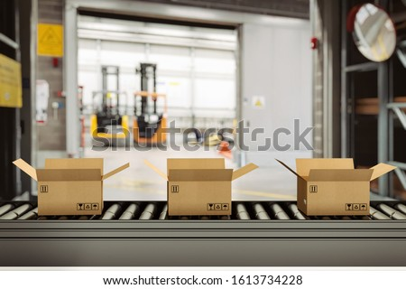 Cardboard boxes on conveyor rollers inside a warehouse ready to be shipped by courier for distribution Royalty-Free Stock Photo #1613734228