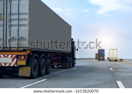 Truck on highway road with container, transportation concept.,import,export logistic industrial Transporting Land transport on the asphalt expressway againt blue sky #1613820070