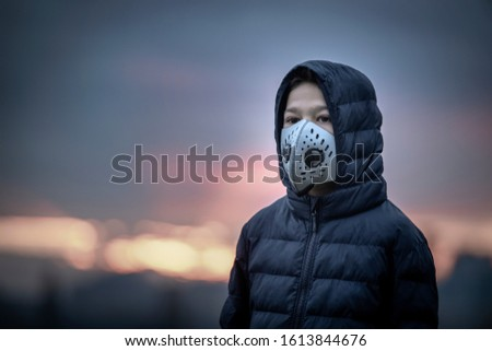 Air Pollution Concept, Young Boy with Breathing Mask, Smoke in the Background #1613844676