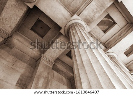 Antique stone column of a old building close-up. Royalty-Free Stock Photo #1613846407