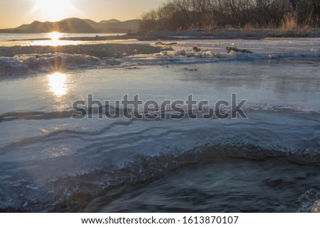 A frozen river at early morning in the mid winter. #1613870107