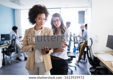 Business people working and brainstorming in office #1613929972