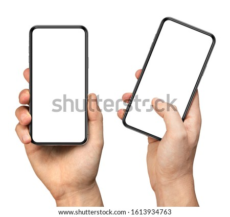 Man hand holding the black smartphone with blank screen and modern frameless design - two versions simple with vertical screen and angled with touching screen with finger - isolated on white #1613934763