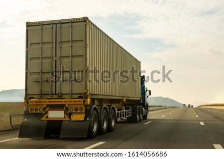 Cargo Truck on highway road with container, transportation concept.,import,export logistic industrial Transporting Land transport on the expressway againt sunrise sky #1614056686