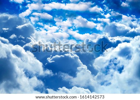 Dramatic Cloudscape Background with a Blue Sky #1614142573