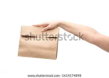 cropped view of woman holding paper bag isolated on white #1614174898