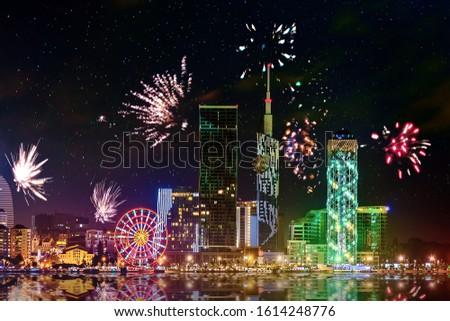 Beautiful night landscape with salute and fireworks in Batumi city at night. Night reflections of lights in Black Sea port of Batumi, capital of Adjara. Georgia. #1614248776
