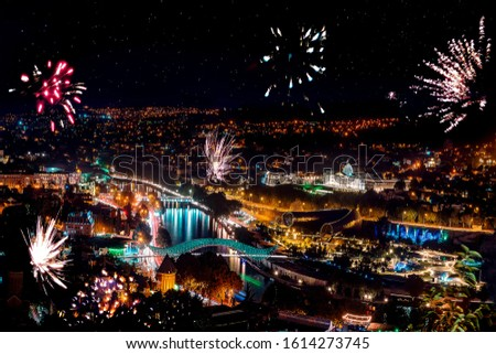 Beautiful night landscape with salute and fireworks in Tbilisi city, Georgia #1614273745