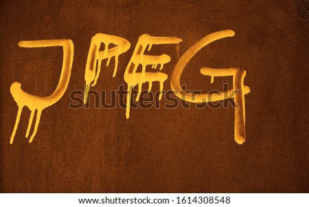 JPEG word painted on rusty metal wall. image, photo  format