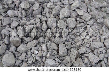 Pile of broken, rough stones in this photo. Captured in the form of background, texture or pattern. #1614328180