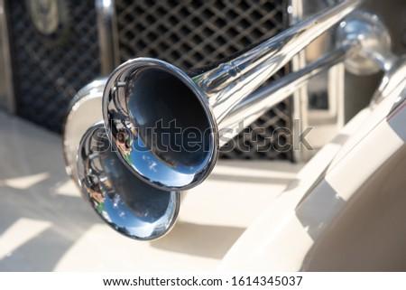 Shiny cHromed horn on vintage car #1614345037