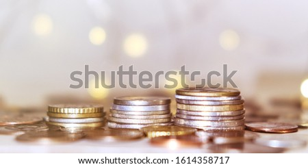 Coins stacked in stacks on a colored background with a side #1614358717