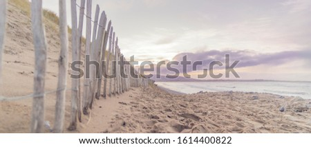The Irish coastal of Strandhill County Sligo on the Wild Atlantic Way. The beach at sunset on a calm winters evening. Royalty-Free Stock Photo #1614400822