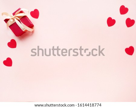 Gift box and hearts on pink background. Saint Valentine's day. #1614418774