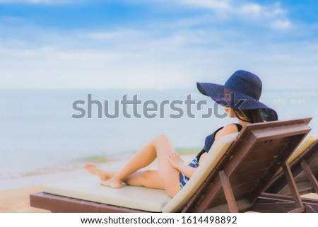 Portrait beautiful young asian women relax smile happy around sea beach ocean for vacation travel in holiday #1614498892