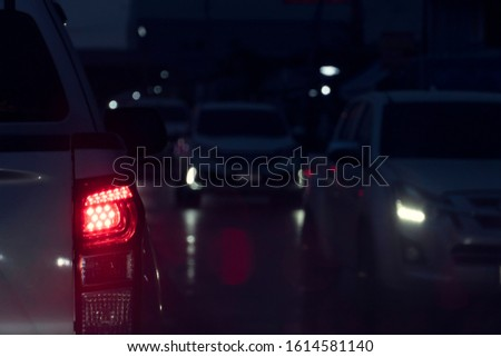 Blurred image of cars on the road with light break at in night. #1614581140