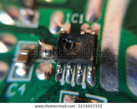 Transistor on electrical equipment circuit board damage from short circuits or lightning strikes, Selective focus. #1614655192