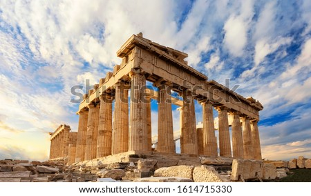 Parthenon temple on a sinset. Acropolis in Athens, Greece. The Parthenon is a temple on the Athenian Acropolis in Greece, dedicated to the goddess Athena. #1614715330