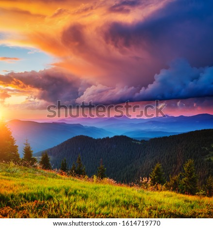 Exotic landscape in the mountains at sunset. Picture of colorful cloudy sky. Location place of Carpathian national park, Ukraine, Europe. Idyllic natural wallpaper. Discover the beauty of earth.