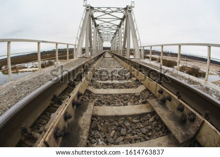 Photography of russian railway in the winter. Railway reinforcement on a bridge over a river. Fish eye lens. #1614763837