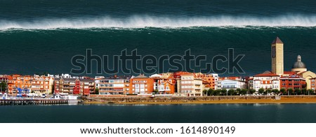 tsunami with a big wave crashing a town in the coast