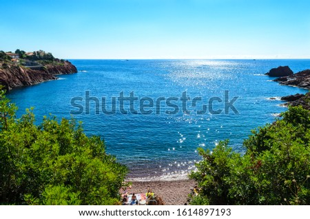 Beautiful famous view on cote d'azur (Cote de Azur, dazur), blue sky, sea. Plage Abel Baliff, french riviera, nearby Saint-Raphael, Frejus, between Cannes and Saint-Tropez. France, Provence Royalty-Free Stock Photo #1614897193