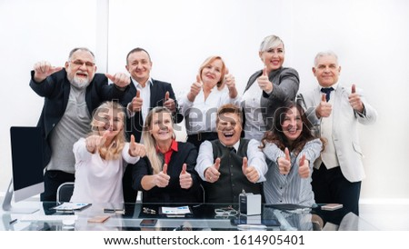 large group of happy employees showing their success #1614905401