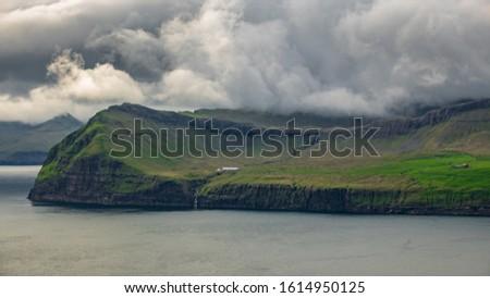 Faroe islands coastline with stormy weather #1614950125